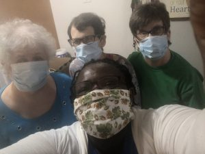 Four women wear face masks during COVID-19.