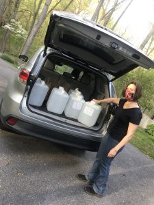 Senator Katie Fry Hester and her neighbors donated 30 gallons of hand sanitizer from Patapsco Distlling Company to The Arc of Howard County.