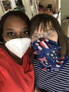 Two women wear face masks during COVID-19.