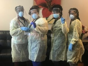 Nurses and DSPs Ready for Shift Wearing PPE, Gowns, Gloves, Masks, and Face Shields